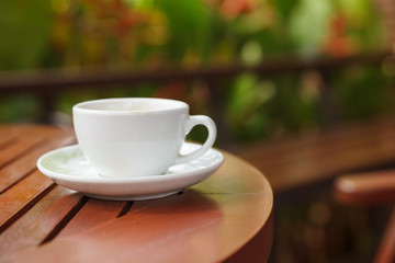a cup of coffee and blurred bokeh background