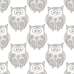 Seamless vector pattern with cartoon doodle owls. Cute birds with hand drawn floral ornament. Trible animal silhouettes on white background. Coloring page for children and adult.