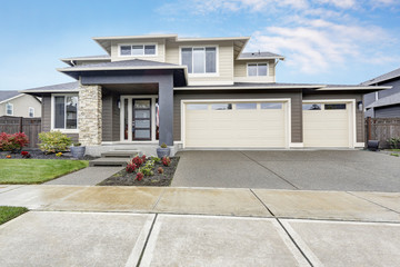 Curb appeal of brand-new home in brown and beige colors