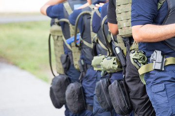 law enforcement training team with tactical equipment and tactic