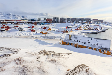 Old harbor and Nuuk city center covered in snow, Greenland