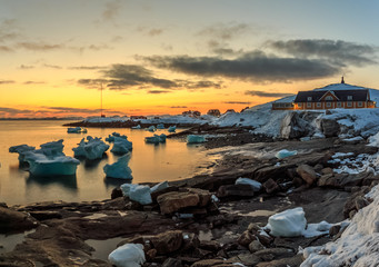 Poster Arctic Nuuk city old harbor sunset view with icebergs, Greenland