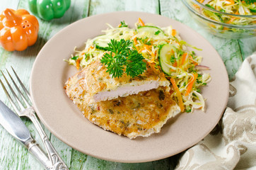 Pork chop in batter with vegetable salad