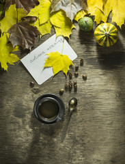 Colorful autumn leaves with pumpkins and a cup of coffee