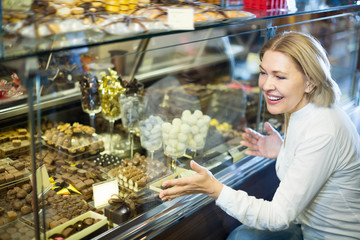 Adult pensioner buying chocolate