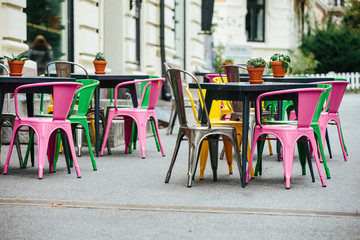 Street cafe. Europe. Cloudy weather is cold.