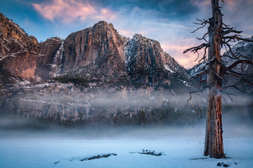 Yosemite valley with morning fog and snow