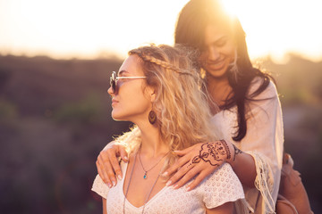 two mehendi style women outdoors