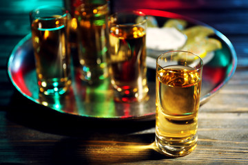 Gold tequila shot in bar