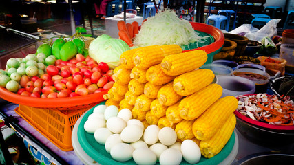 Veggies and fruits, papaya , tomato , corn , mango , salted egg , eggplant , garnish for papaya Salad Shop Popular menu in Thailand.