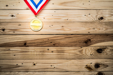 Award of Victory. Winners at the best games, gold medal On the wall of wood