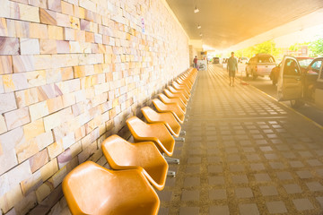 Empty chairs for wait car or taxi at airport.