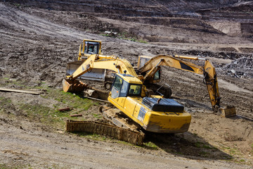 Construction machinery. Excavation work at the construction site