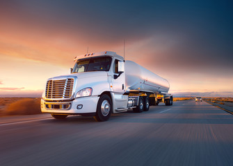 Truck cistern and highway at sunset - transportation background Wall mural