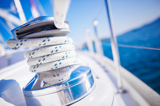 Sailboat winch and rope yacht detail. Yachting