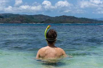 Young man ready to snorkel, Gili Nanggu, Lombok, Indonesia