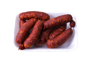 Tray of sausages isolated on white