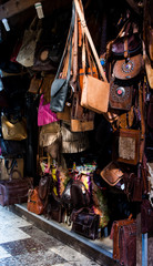 Artisanal craft stall with leather goods in a city, selective focus, city life
