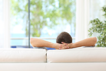 Man relaxed on a couch at home