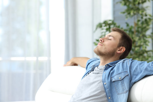 Man resting on a couch at home