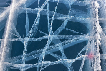 Network of cracks in thick solid ice layer of frozen Lake Baikal