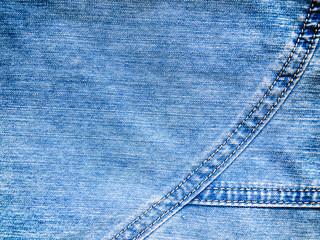 Blue denim background of rough cloth