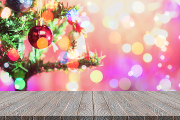 Christmas bokeh background with empty wooden table. Perfect for display