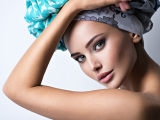 Sexy portrait of a beautiful girl with turban on head.