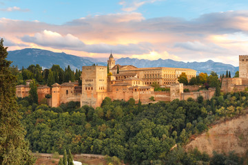 Fototapete - Palace and fortress complex Alhambra with Comares Tower, Palacios Nazaries and Palace of Charles V during sunset in Granada, Andalusia, Spain