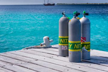 Scuba cylinders on a dock, Bonaire, Netherlands Antilles