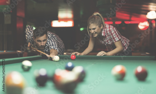 three ladies are playing billiards and having unforgettable threesome  24013