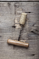 cork and corkscrew on wooden background