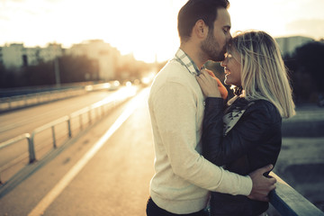Romantic couple in love enjoying sunset