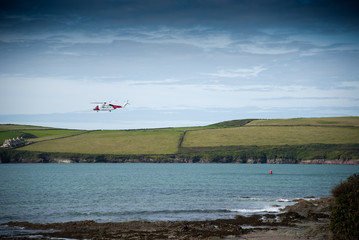Helicopter of the Coast Guard exercises near Daymer Bay in north Cornwall.