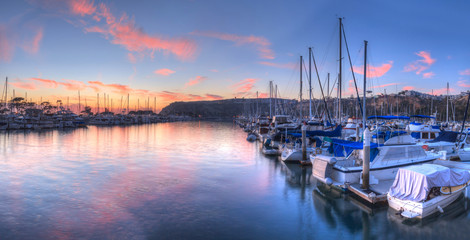 Sunset over sailboats in Dana Point harbor in the fall. Wall mural
