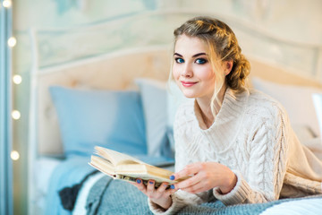 Beautiful teen girl with a book
