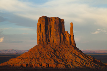 The sun setting over Monument Valley, Utah
