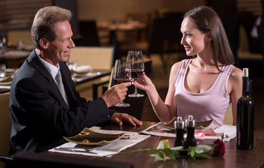 Happy couple drinking wine in the restaurant