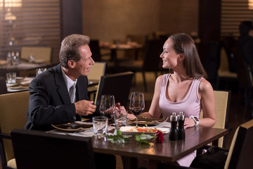 Pleasant couple communicating in the restaurant