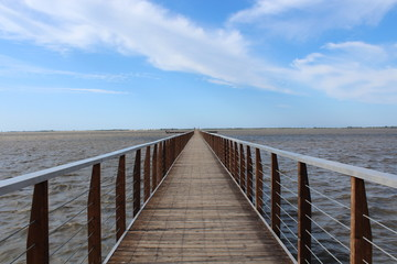 Lesina Lake and walkway leading to the island of San Clemente