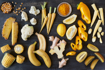 Food background variety assorted yellow toned fruit and veg