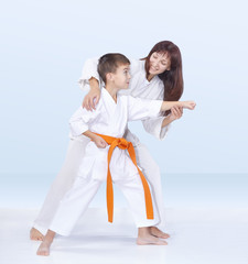 Mother and son are training karate kick