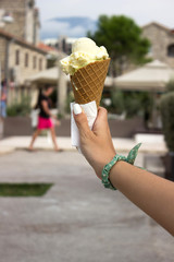Ice cream in hand. Girl holds ice-cream in her hand in the old b