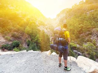 Man on Mountain Range at Sunrise.