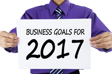 Businessman showing text of business goals for 2017