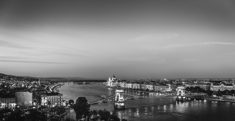 Budapest, Hungary. Aerial view on city lights, center in evening dusk. Black and white scene.