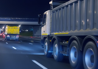 dump trucks transport freight on the night