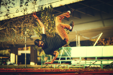 BBoy doing  jump stunt on street