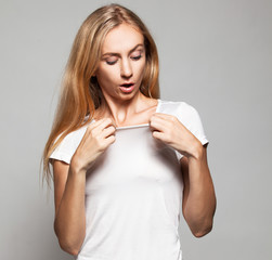 Woman with a surprised look on his chest