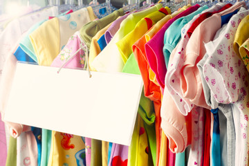 Set of clothes for kids on hangers. Shopping.